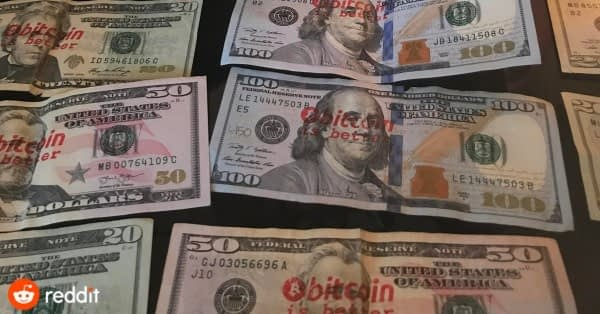 defaced money by Bitcoin stamp